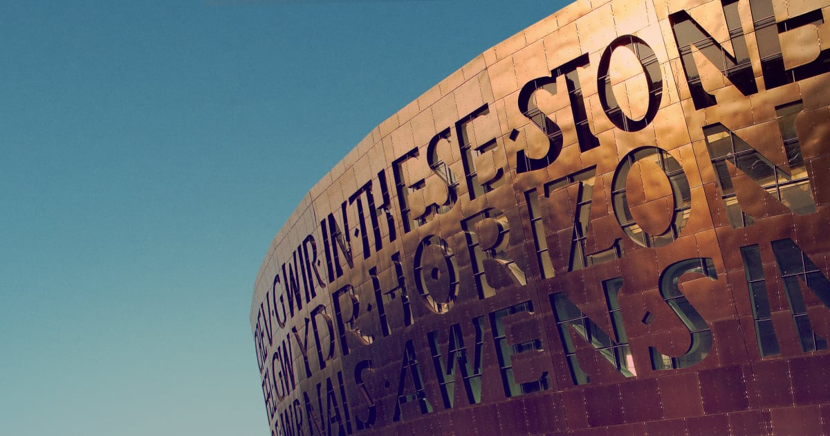 Image of the front of Wales Millennium Centre against a blue sky